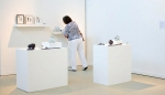 A visitor viewing ceramics by Elaine Bolt on display at the MAde 2012 show
