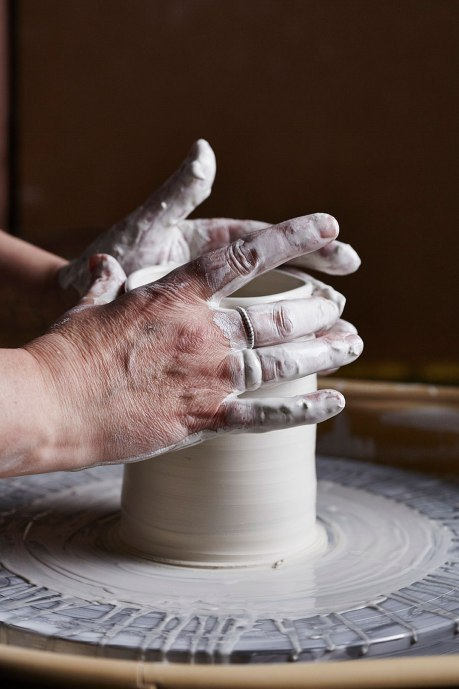 Elaine Bolt throwing with porcelain (image by Alun Callender)
