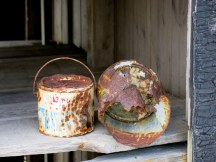 Dungeness, rusty paint tins